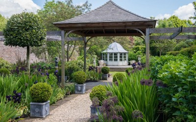 outdoor wedding venue - pagoda with lawn for guest-seating beyond