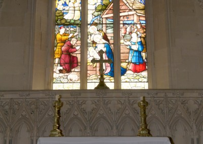 Stain glass window above altar